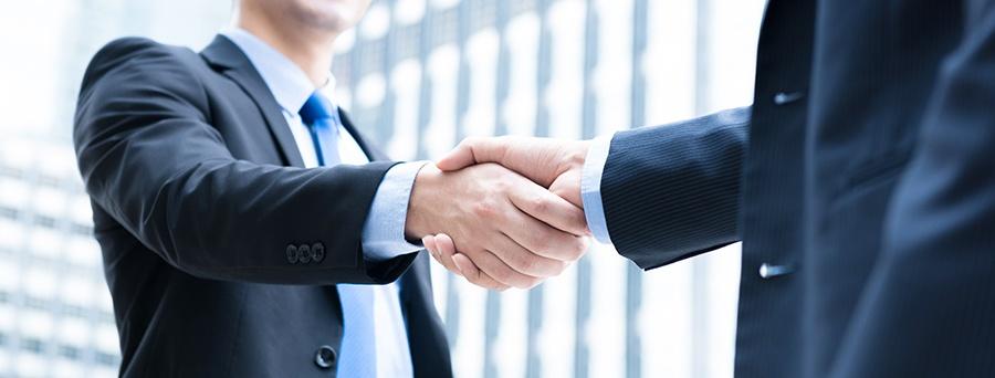 mojo-blog-cheesy-stock-images-cliche-handshake